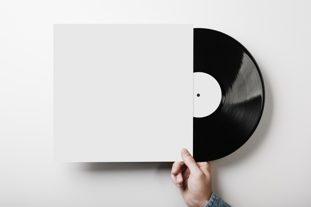 Man removing vinyl record from sleeve
